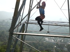 Felicity Feline hiking and climbing towers with a view