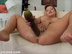 Big butt and huge breasted babe fucks her pussy with a massive brutal dildo