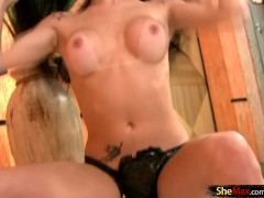 Feminine shebabe slips out of her black latex bra and thongs