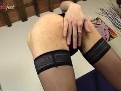 Redhead crosddresser shows her beautiful feet in black stockings