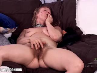 Natasha rubs her hairy pussy and moans