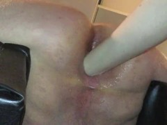 Femdom ass fist male slave in chair