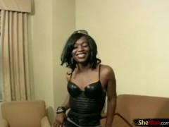 Feminine ebony shedoll is dancing in black leather corset