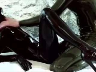 Naughty black latex kitty on webcam: getting oily massage from rubber boy