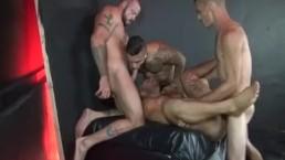 Darkroom group sex