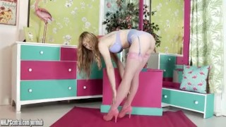 Sweet blonde teen Lucy Mae strips and plays in delicate lingerie and nylons