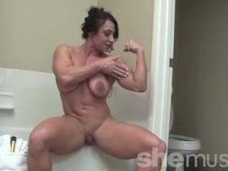 female bodybuilder brandimae's posing for you as she gets ready for a bath