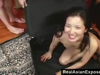 RealAsianExposed - Petite Asian in a suitcase.
