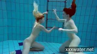 Milana and Katrin strip eachother underwater