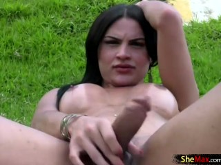 big breasted shegirl strokes her boner outside and cumshots