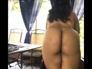Ebony babe teasing outdoors