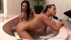 Pissing and pussy licking for busty brunette girls in the bath before dildo