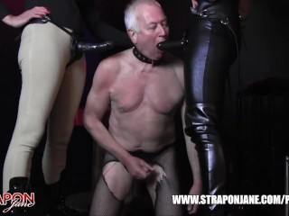Femdoms in latex dominate tag team sissy face fuck with strapon as he wanks