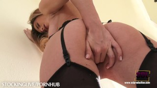 Blonde dream girl Cara enjoying herself in stockings