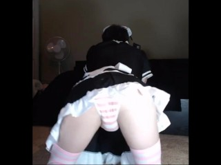 Slutty femboy in maid outfit shows off his ass