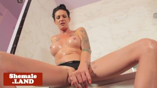 Showering bigtitted trans teasing and wanking