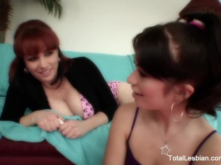 Redheaded MILF fucks teaches young brunette how to fuck