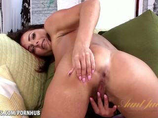 Helena's pretty painted nails rub her pink pussy