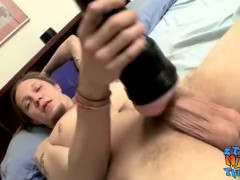 Long haired twink Max Ward strokes his massive fuck stick