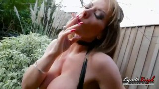 UK Housewife Milf Lynda Dressed in Latex Smoking Outside  milf smoking outside mom blonde public english milf kink smoking latex mother big boobs lyndaleigh smoke dirty talk
