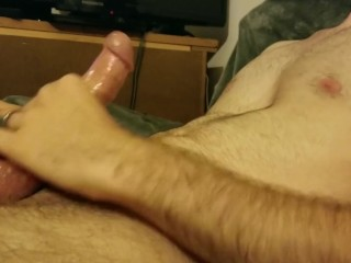 Hot guy strokes thick cock and cums.