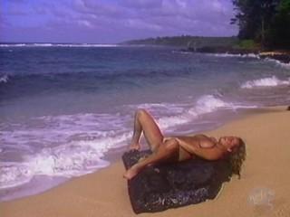 Huge tits jiggle while she masturbates on the beach