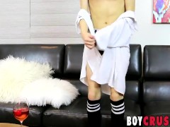 Naughty twink Greco Rai jacks off on the couch all alone