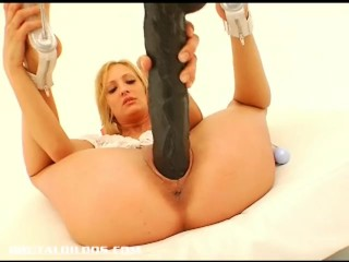Slutty blonde Marley gaping herself with a huge dildo