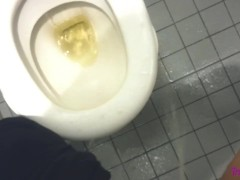 Milf making a mess in public toilet - Pissing on floor and on toilet