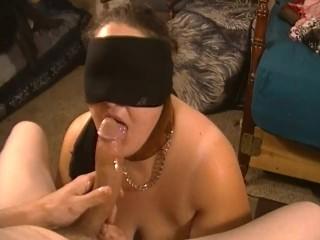 Blindfolded slut gives sloppy head
