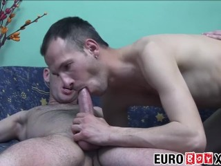 Pretty twink enjoys a bareback spit roasting in a threesome