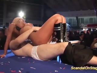 facesitting on public sex fair show stage