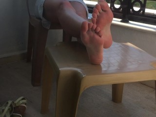 Feet And Pussy Showing. She Plays With Feet And Pussy On A Public Balcony