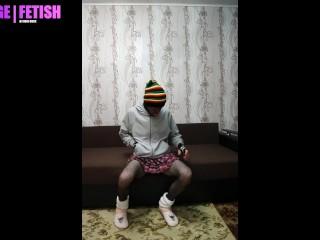 Boy in pink skirt and fishnet tight, slipper socks