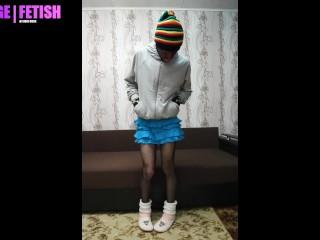 Boy in blue skirt and fishnet tight, slipper socks