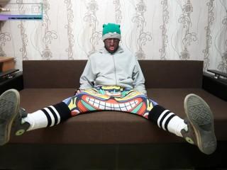 Encased hoodie in sweatpants and tube socks in sneakers