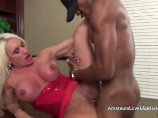Muscular mature blonde impaled by big black cock