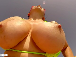 Topless at the Beach: Britney Swallows big wet MILF tits slow motion bounce