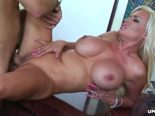 busty blonde bombshell gets her pierced fuck hole plowed hard