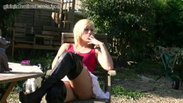 Naughty smoking blonde lets you upskirt at her pussy in sexy leather boots