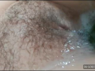 Wanking my huge tits with a cucumber and fucking my pusy with the shower