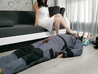 Foot job and shoe worship while mistress tries differnt shoes