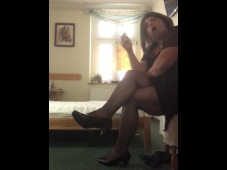 Transvestite in sexy linergie smoking cigarette