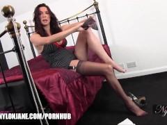 Milf slips her long legs inside silky nylon stockings and feet in stilettos