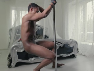 Kinky black male stripper dancing sensual on the pole