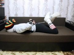 Encasement bondage in sweatpants striped socks and slipper boots