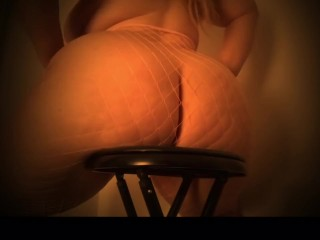 Curvy blonde playing with pussy and curves on chair