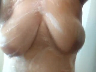 Playing with my breast while I shower