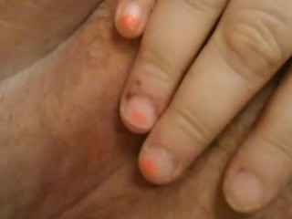 Opening pussy lips to reveal clit