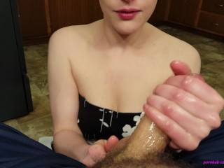 Young step mom gives an oily handsy blowjob, gagging on cum